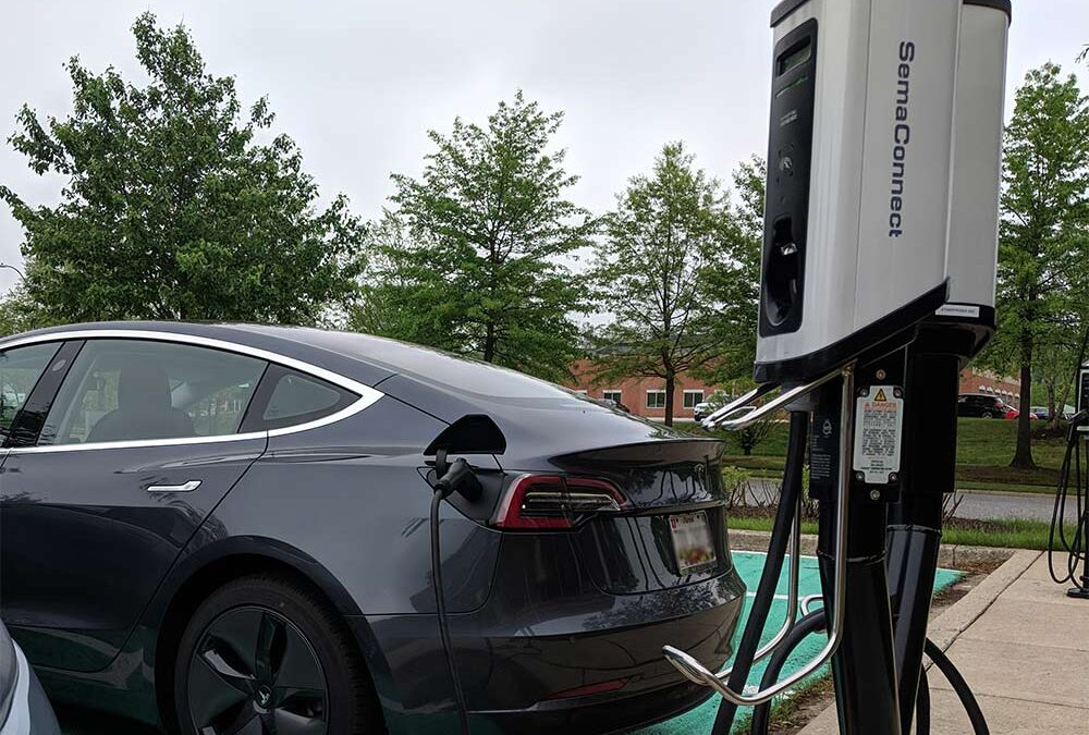 Tesla charging at the Series 5 smart charging station, designed for dedicated charging