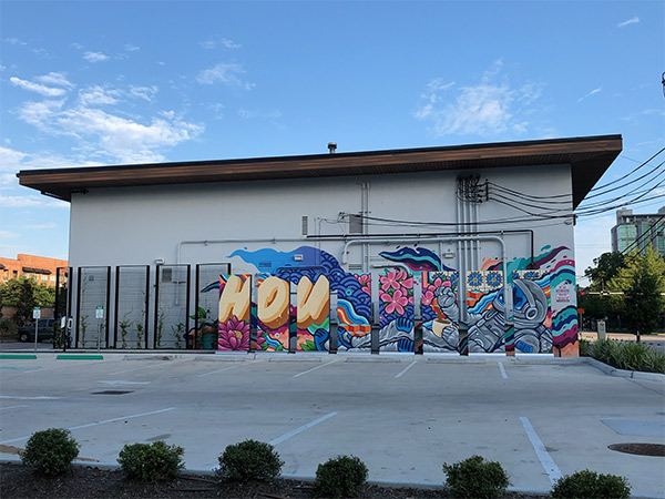 Custom mural at 2101 Smith St next to SemaConnect EV charging stations